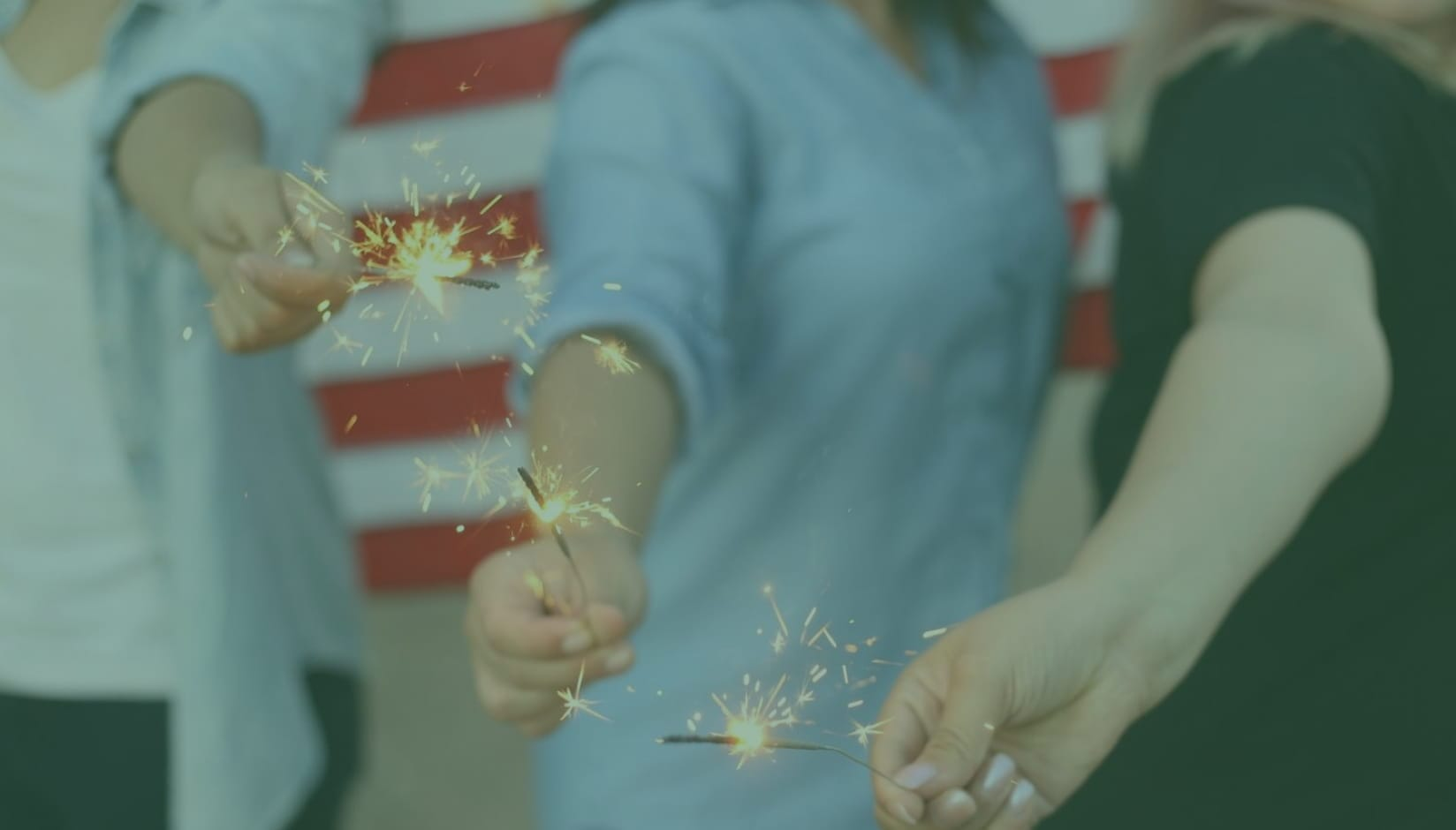 Three people holding sparkles